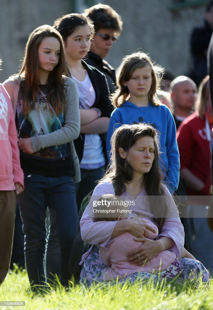 A woman holds a young child as members of the community of Machynlleth stand in the church yard of St Peter's Church for a service with prayers for missing five-year-old April Jones on October 7, 2012 in Machynlleth, Wales. Hundreds of local people walked from April's home in Bryn-y-Gog to the local church in the centre of Machynlleth where the Bishop of Bangor Andrew John officiated. Police have charged local man Mark Bridger with murder, child abduction and attempting to pervert the course of justice. Five-year-old April Jones was abducted from outside her house on Monday night in Machynlleth.
