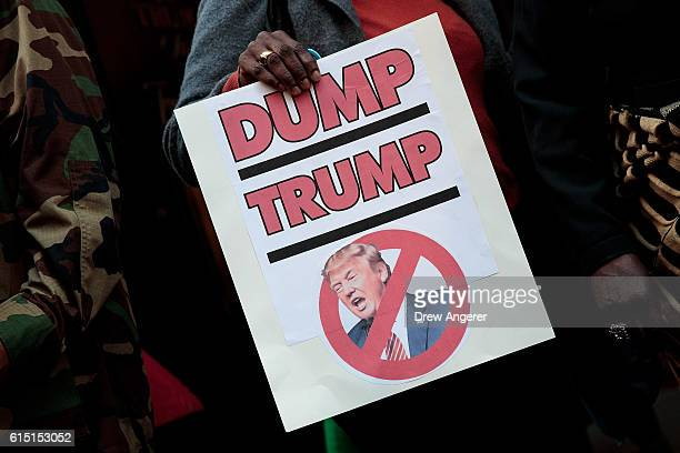 A woman holds an antiTrump sign during a protest against Republican presidential candidate Donald Trump for his 'treatment of women' in front of...