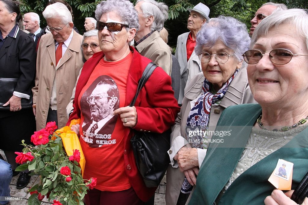 A woman holds flowers and wears a tee shirt with a picture of Josip Broz Tito as people gather to comemorate his birthday in Sarajevo, on May 25, 2013. As the last Yugoslav king Petar II Karadjordjevic was reburied in Serbia on May 26, hundreds of supporters of his post-World War II political rival, communist leader Josip Broz Tito, marked the 121st anniversary of his birthday throughout his former homeland. Josip Broz was born on May 25, 1892 in Croatia. He later became Yugoslav communist party leader and a lifetime president of Yugoslavia. He died on May 4, 1980 and after his death Yugoslavia fell apart and the socialist ideas mostly vanished in the region torn apart by nationalist policies led by his successors in all ex-Yugoslav republics.