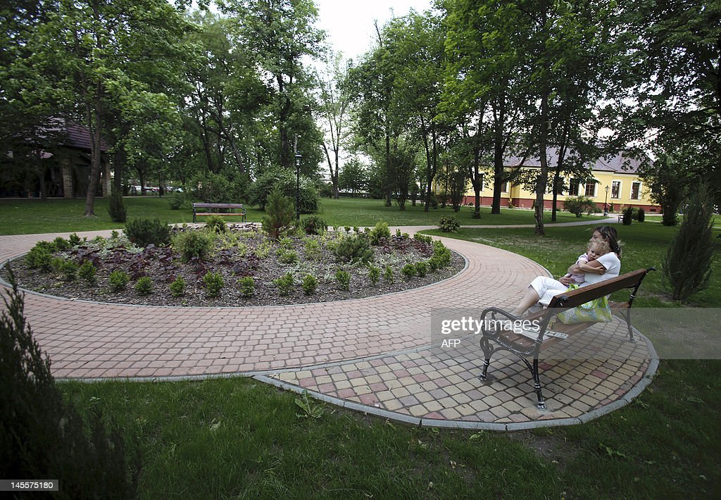 A woman holds her baby as she sits on a bench in Freedom square in Gyomro town on May 24, 2012. The decision to rename the main square of a Hungarian town named after the former Hungarian Regent Miklos Horthy, from 1920 to 1944, an ally of Adolf Hitler, evokes emotion and shows a certain rise of nationalism to extreme right in the country. AFP PHOTO / PETER KOHALMI
