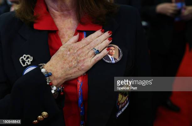 A woman holds her hand to her chest during the Pledge of Allegiance during the third day of the Republican National Convention at the Tampa Bay Times...