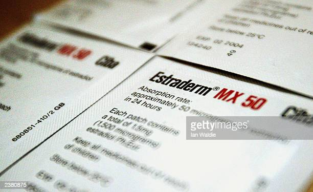 A woman holds her HRT patches August 8 2003 in London Drug safety watchdogs have annouced that the commonlyused form of HRT also known as combination...