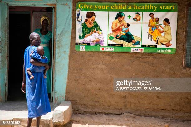 A woman holds her malnourished child in a stabilisation center in Ganyiel Panyijiar county in South Sudan on March 4 2017 South Sudan was declared...