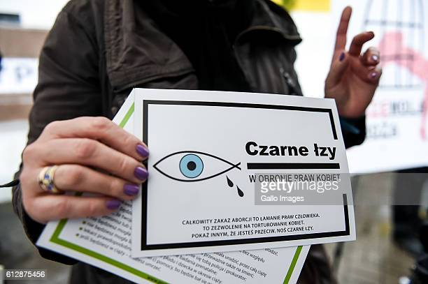 A woman holds leaflets in her hand during the Black Monday a nationwide women's proabortion protest on October 03 2016 at Swietokrzyska Street in...