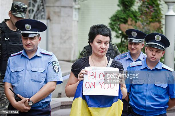 Woman holds placard which says quotBlood on youquot in front of France embassy in Kiev