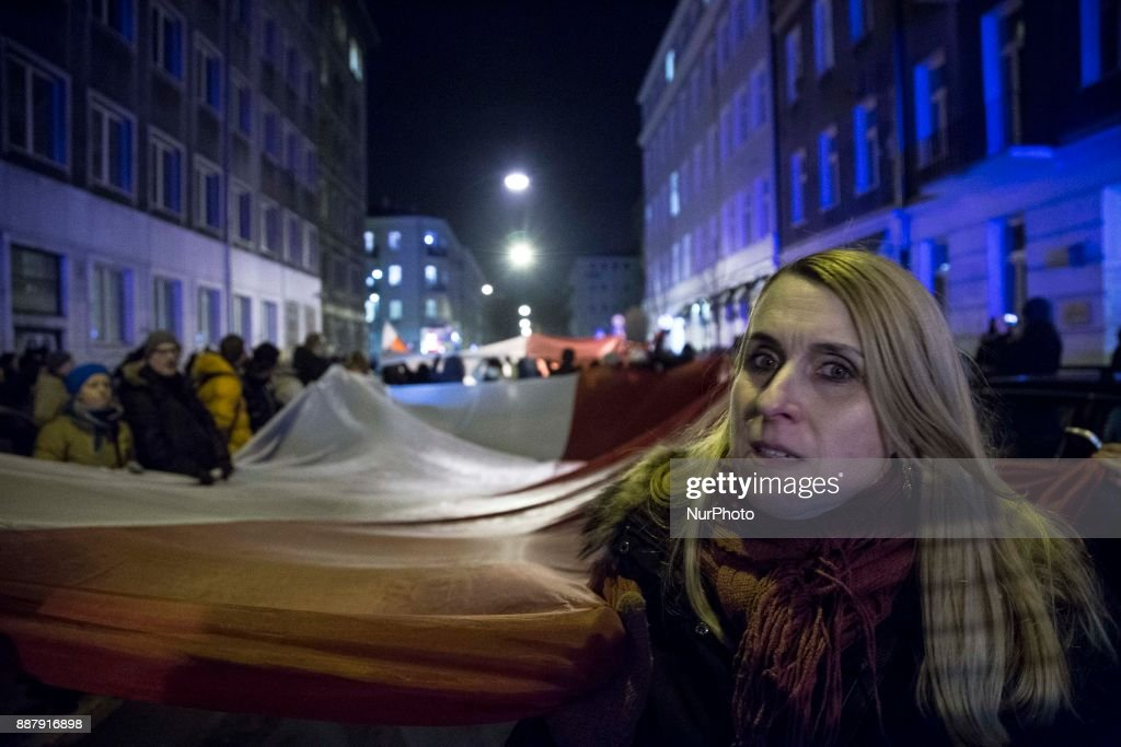 Woman holds polish flag during illegal demonstration near Polish parliament organized by opposition group Obywatele RP in Warsaw on December 7, 2017.