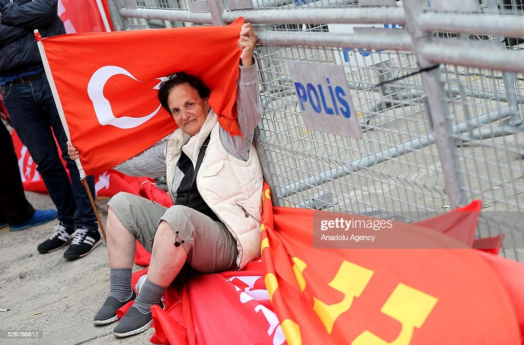 A woman holds Turkish Flag as the workers, organized by labor unions and other labor organization take part in a rally to mark May Day, International Workers' Day in Istanbul, Turkey on May 01, 2016. Every year, May Day is observed and commemorated as an official holiday under the name 'May 1, Labour and Solidarity Day' all around Turkey.