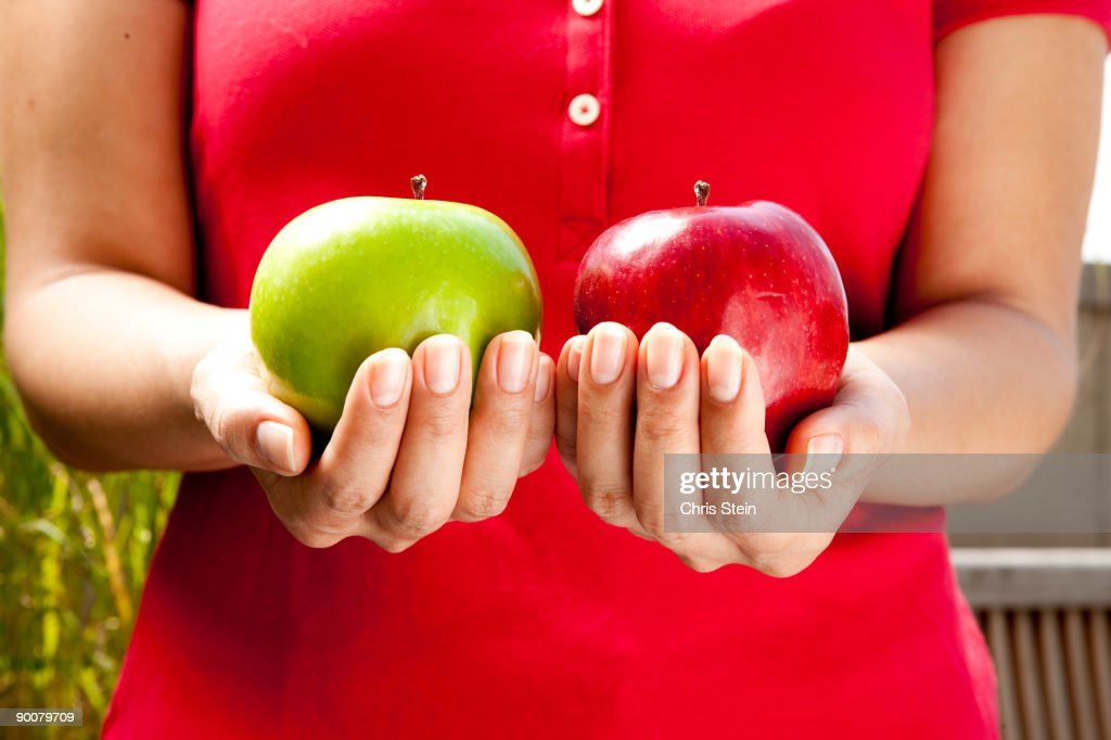 Woman holds two apples : Stock Photo