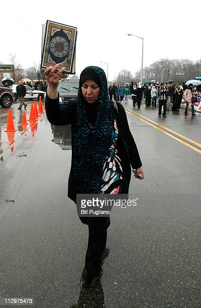 A woman holds up a copy of the Qur'an at the Islamic Center of America prior to a planned protest by Pastor Terry Jones of the Dove World Outreach...
