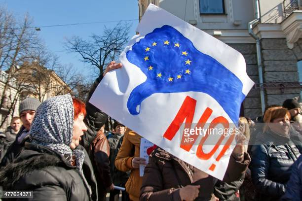 A woman holds up a sign as proRussian demonstrators gather on the sidelines of a Ukrainian Democratic Alliance for Reform party rally in the eastern...