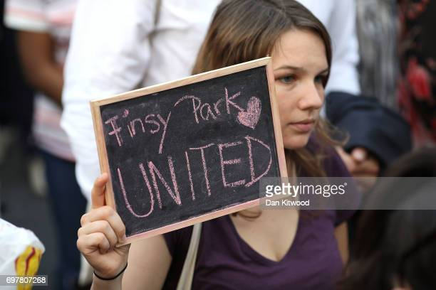 A woman holds up a sign as she attends a vigil outside Finsbury Park Mosque on June 19 2017 in London England Worshippers were struck by a hired van...