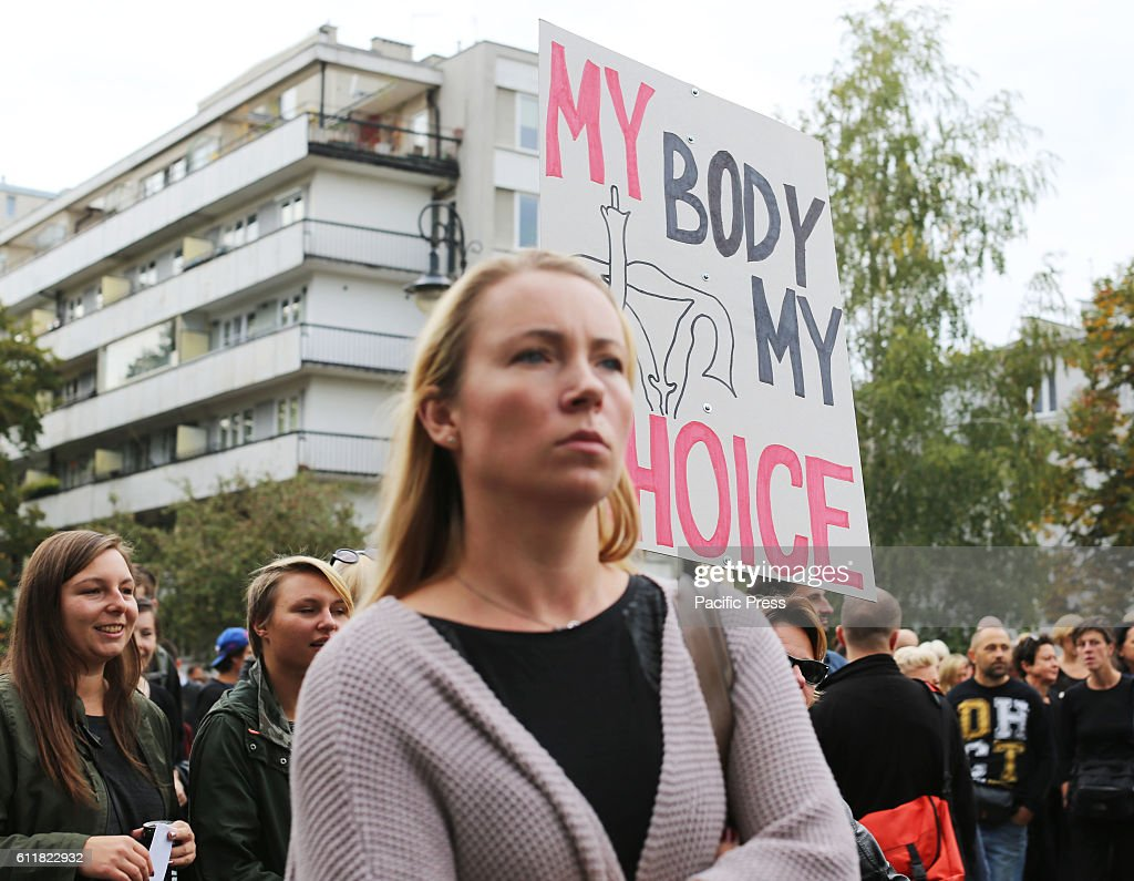 naturist family incest A woman holds up a sign reads 'My body My choice' during a protest