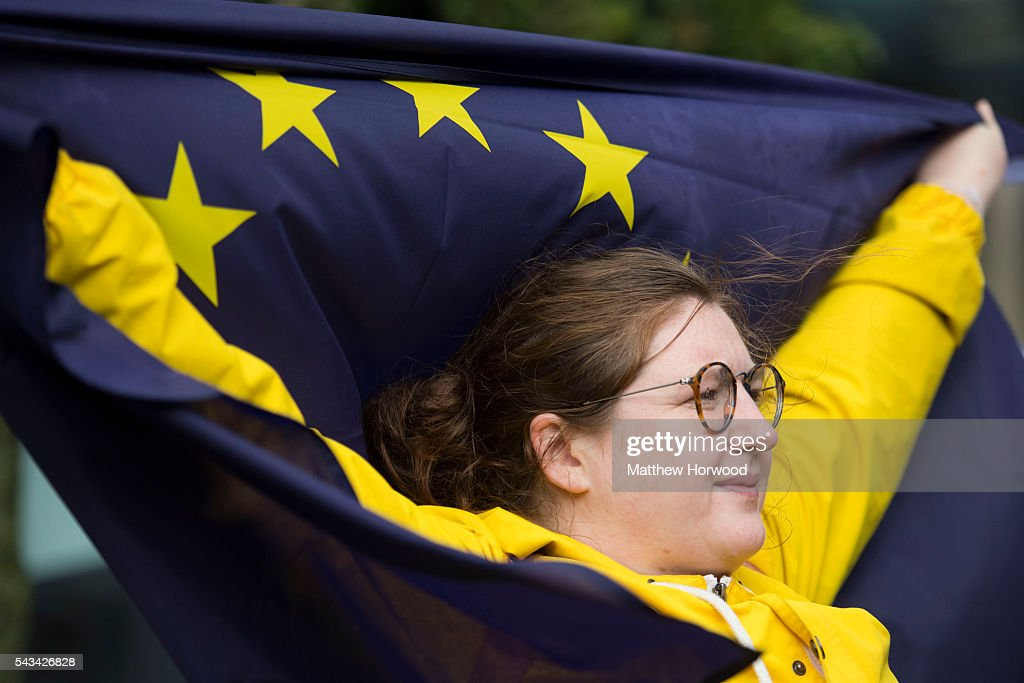 A woman holds up an EU flag during an anti-Brexit rally on June 28, 2016 on the Hayes in Cardiff, Wales. The protest is at a time of economic and political uncertainty following the referendum result last week, which saw the UK vote to leave the European Union.