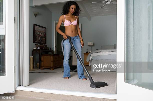 A woman hoovering