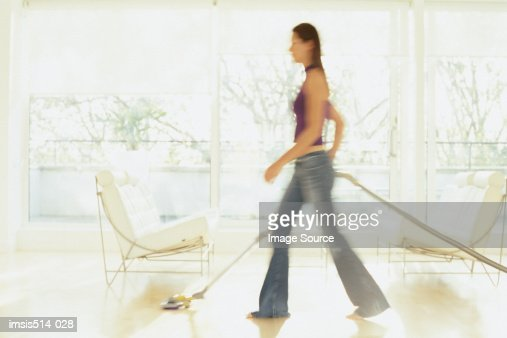 Woman hoovering : Stock Photo