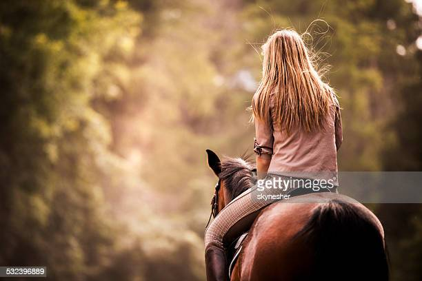 Femme Monter à cheval.