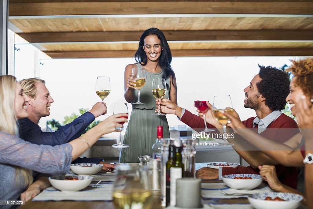 Woman hosting a dinner party