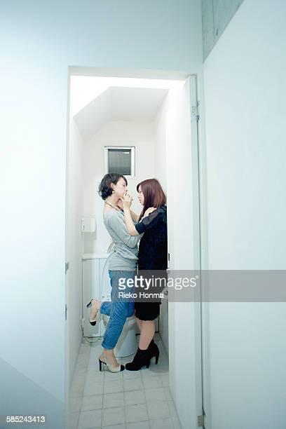 woman hugging androgynous man