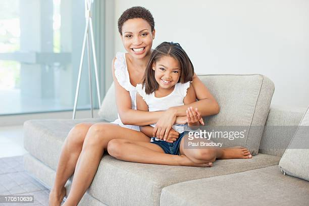 Woman hugging  daughter