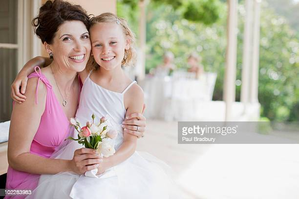 Woman hugging flower girl