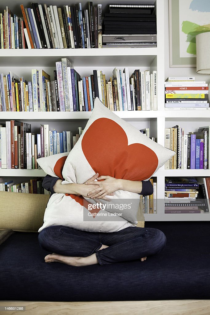 Woman Hugging heat pillows : Stock Photo