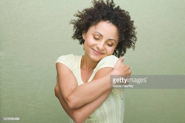 Woman hugging herself, Close-up.