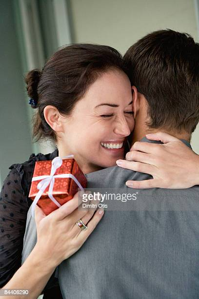 Woman hugging man after reciving a gift