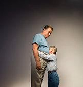 Woman hugging man's stomach