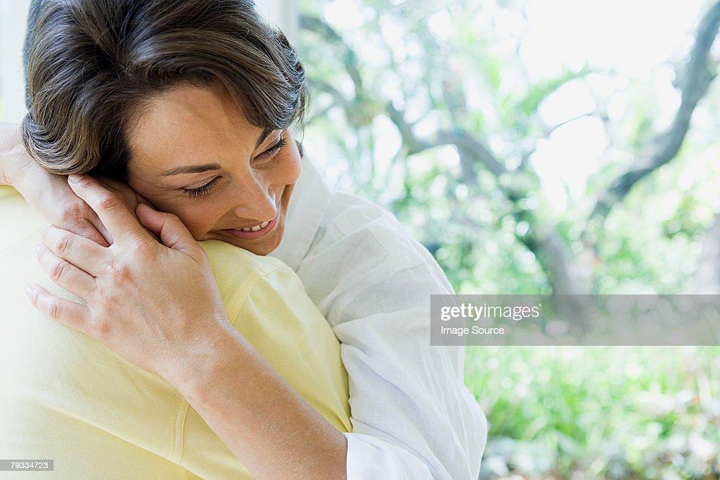 Woman hugging : Stock Photo