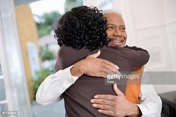 Woman Hugging Senior Father