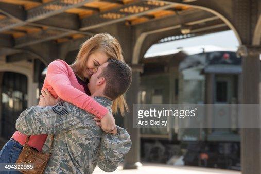 Woman hugging soldier boyfriend