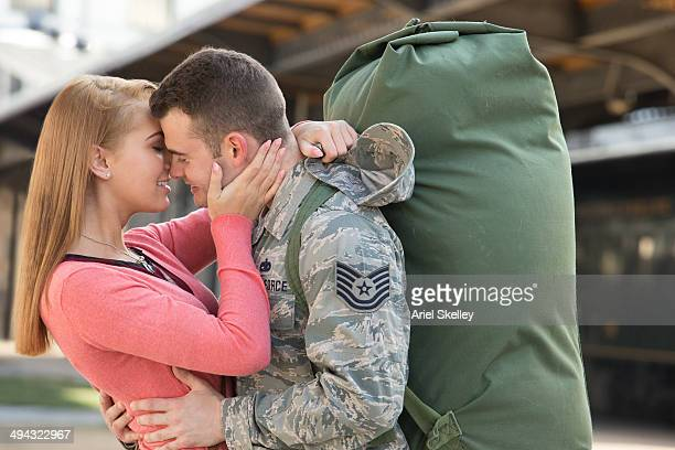 Woman hugging soldier boyfriend