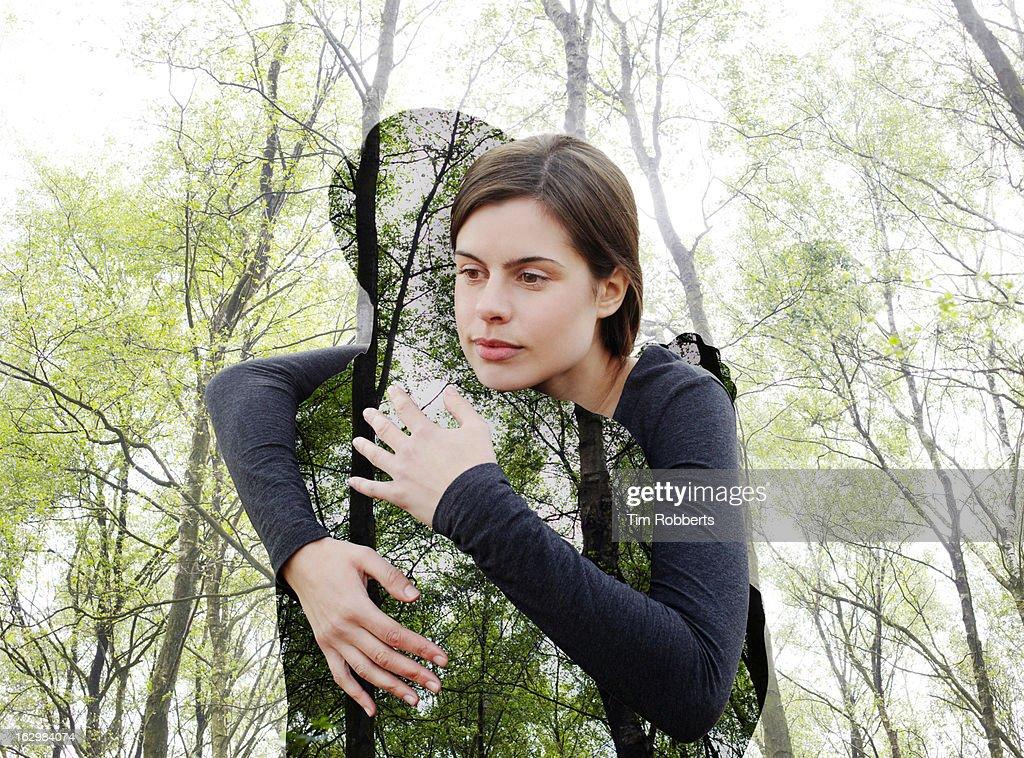 Woman hugging the environment. : Stock Photo