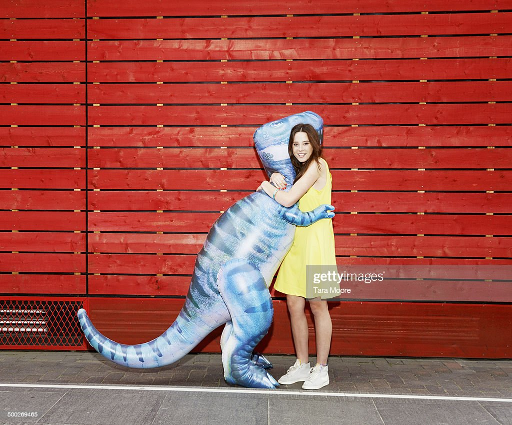 woman hugging toy dinosaur