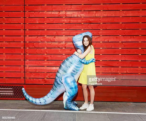 woman hugging toy dinosaur