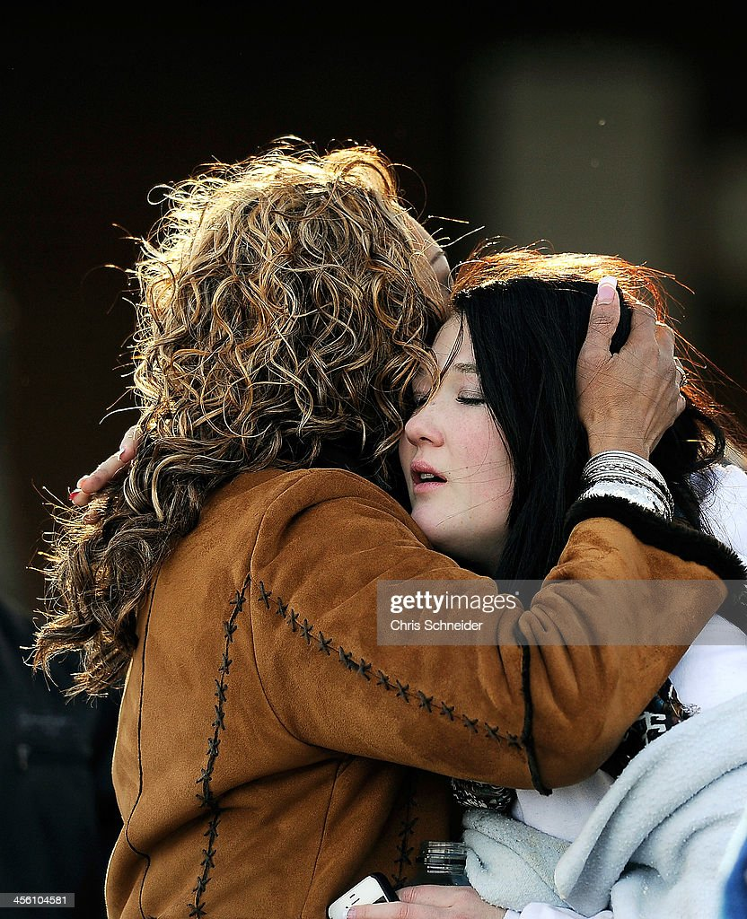 A woman hugs a student at Shepherd of the Hills Church near Arapahoe High School after a school shooting on December 13, 2013 in Centennial, Colorado . According to authorities, two students were injured by a lone gunman who later died of a self-inflicted gun shot wound.