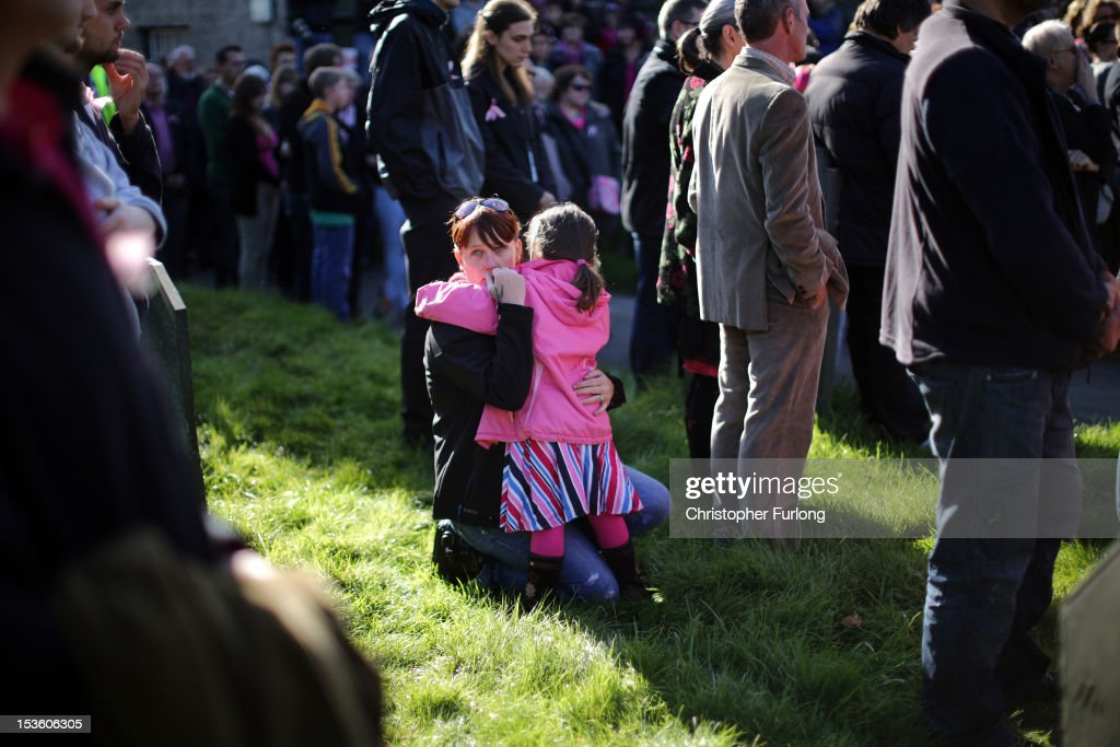 A woman hugs a young child as members of the community of Machynlleth stand in the church yard of St Peter's Church for a service with prayers for missing five-year-old April Jones on October 7, 2012 in Machynlleth, Wales. Hundreds of local people walked from April's home in Bryn-y-Gog to the local church in the centre of Machynlleth where the Bishop of Bangor Andrew John officiated. Police have charged local man Mark Bridger with murder, child abduction and attempting to pervert the course of justice. Five-year-old April Jones was abducted from outside her house on Monday night in Machynlleth.