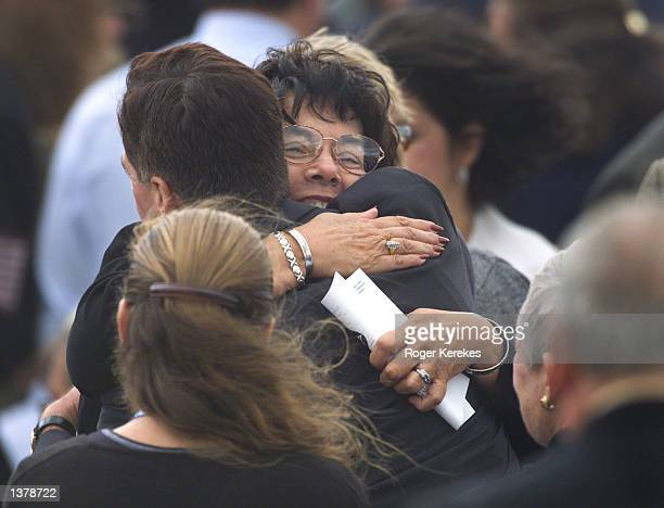 A woman hugs Pennsylvania Governor Mark Schwieker before a memorial service for the passengers and crew of United Airlines Flight 93 September 11...