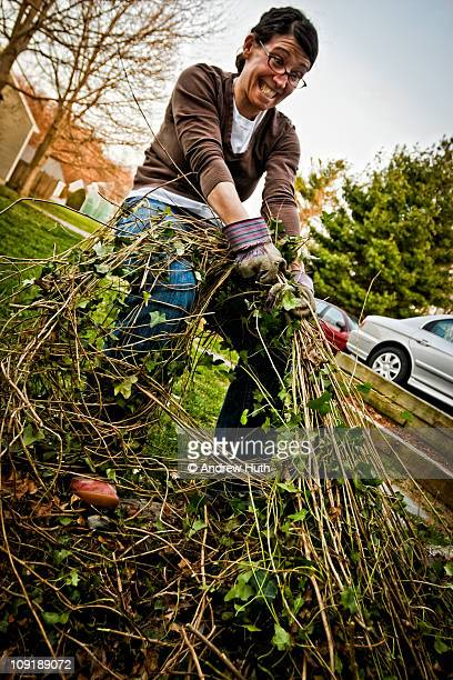 Woman Humorously Struggling to Pull Weeds