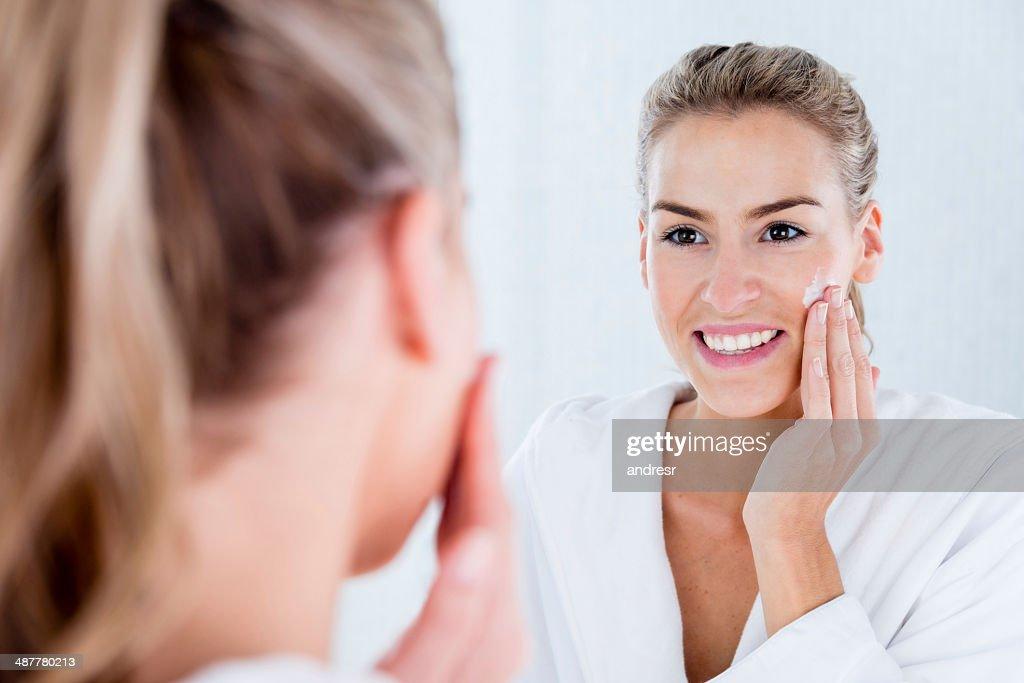 Woman hydrating her skin