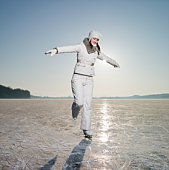 Woman iceskating on lake, smiling