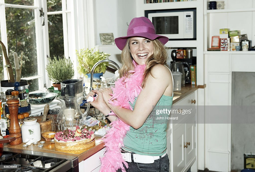 Woman icing cake : Stock Photo