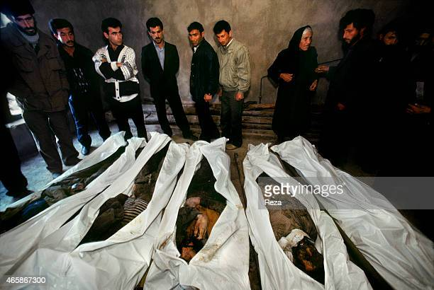 A woman identifies her relative among the bodies in a makeshift morgue in February 1992 in Aghdam Azerbaijan following a mass killing in Khojaly...