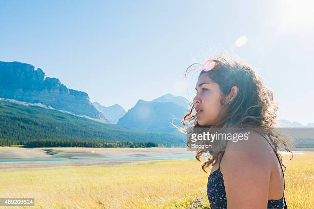 Woman in 20s Views Scenic Landscape in Glacier National Park