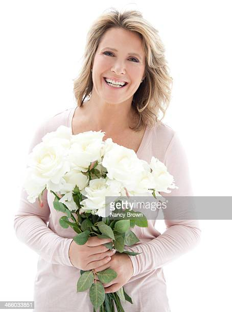 Woman in 50's with flowers