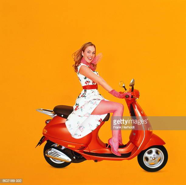 Woman in 50's-style costume, on scooter (Digital Enhancement)
