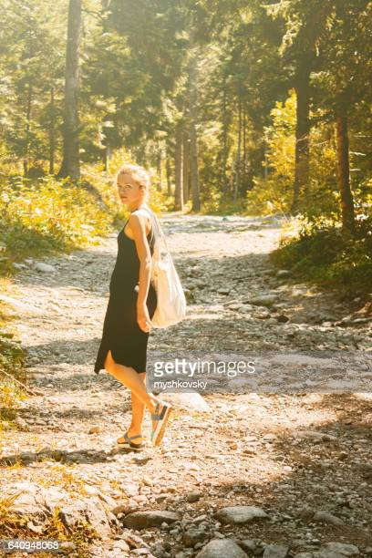 Woman in a black dress in the forest
