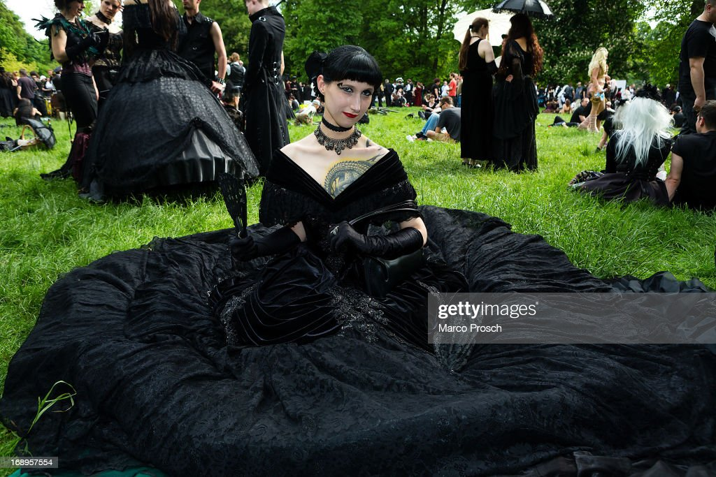A woman in a black dress sits on the lawn during the traditional park picnic on the first day of the annual Wave-Gotik Treffen, or Wave and Goth Festival, on May 17, 2013 in Leipzig, Germany. The four-day festival, in which elaborate fashion is a must, brings together over 20,000 Wave, Goth and steam punk enthusiasts from all over the world for concerts, readings, films, a Middle Ages market and workshops.