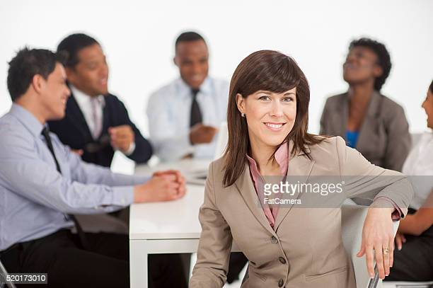 Woman in a Boardroom Meeting
