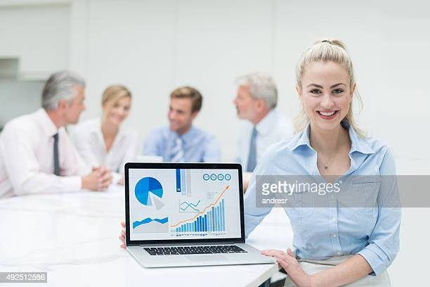 Woman in a business meeting presenting statistics
